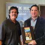 Dean Sargent of Certified Folder Display Service presents the award to Ross Johnson of Ross Johnson Design Company.